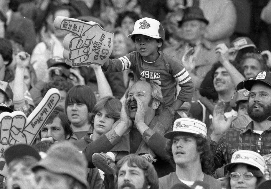 Jan. 10, 1982: A lot of things have changed in 30 years, but foam hand technology remains the same. A young fan gets fired up during the San Francisco 49ers playoff game against the Dallas Cowboys. Photo: Mike Maloney, The Chronicle / ONLINE_YES