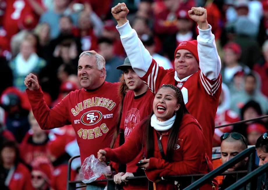 Dec. 30, 2012: San Francisco 49ers fans celebrate a touchdown during the fourth quarter of a game against the Arizona Cardinals at Candlestick Park. Note the lack of tobacco products in their hands ... Photo: John Storey, Special To The Chronicle / ONLINE_YES