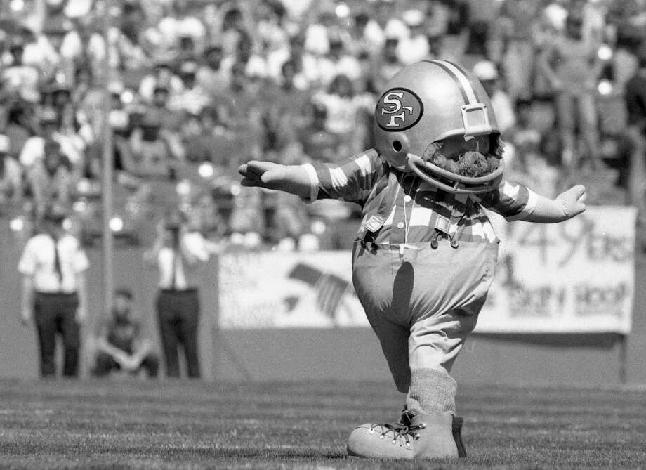 Sept. 15, 1985: The 49ers debut their new mascot, Huddles. It was a league-wide merchandising initiative that included dolls and T-shirts. Thanksfully Huddles was short-lived -- I'd argue this was the worst sports mascot in recent Bay Area history. Photo: Mike Maloney, The Chronicle / ONLINE_YES