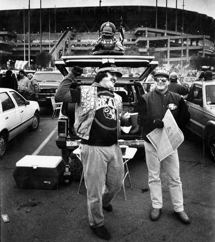 Dec. 14, 1987: San Francisco 49ers tailgaters Michael York and Mark Bersie get fired up before a game against the Chicago Bears. Photo: Michael Gray, The Chronicle / ONLINE_YES