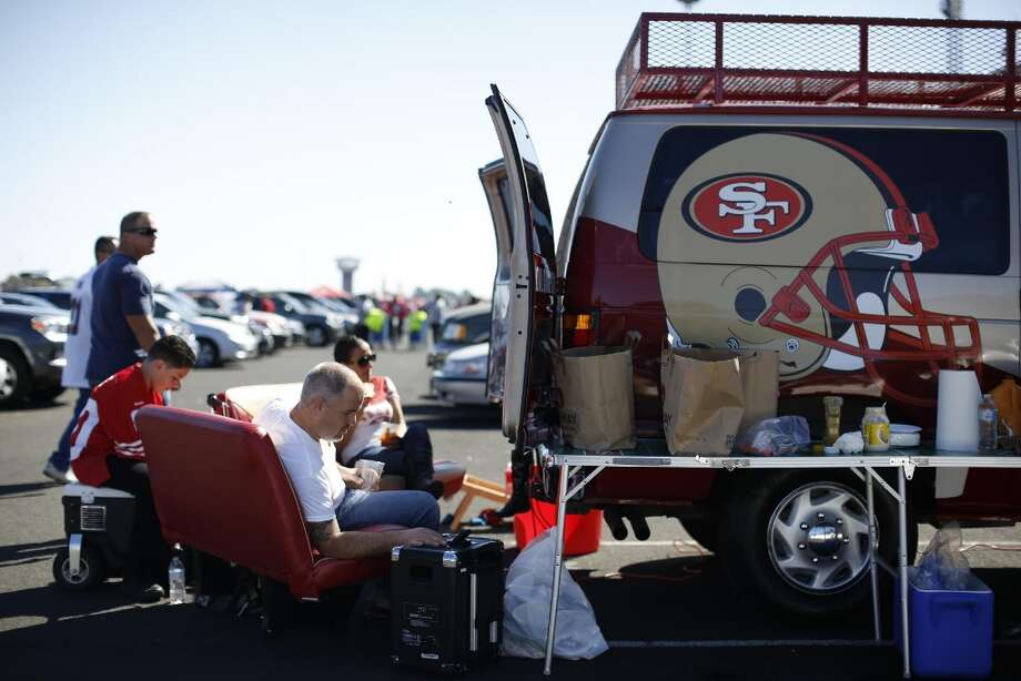 Elliot Tamony, left, sits with his family outside Candlestick Park before the San Francisco 49ers play theNewYork Bills on Sunday October 7, 2012. Photo: Stephen Lam, Special To The Chronicle / ONLINE_YES