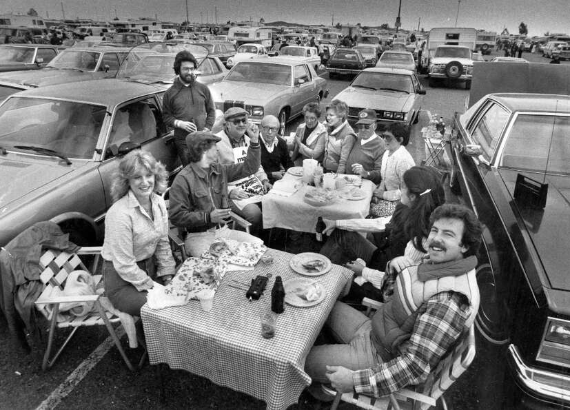 Oct. 23, 1981: A group of fans from Menlo Park enjoy the tailgating action before a San Francisco 49