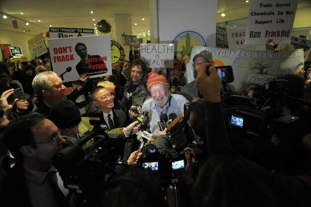 Singer and activist Pete Seeger talks with members of the media during a protest by gas drilling opponents on the concourse level of the Empire State Plaza on Wednesday, Jan. 9, 2013 in Albany, NY.   (Paul Buckowski / Times Union) Photo: Paul Buckowski