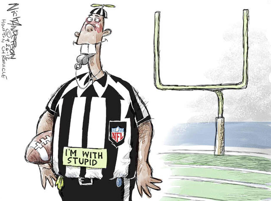 Remember the chaos that ensued when NFL brought in replacement refs in 2012? Well, 56 percent of Americans think they did a better job than Congress. Ouch.  (Nick Anderson / Houston Chronicle)