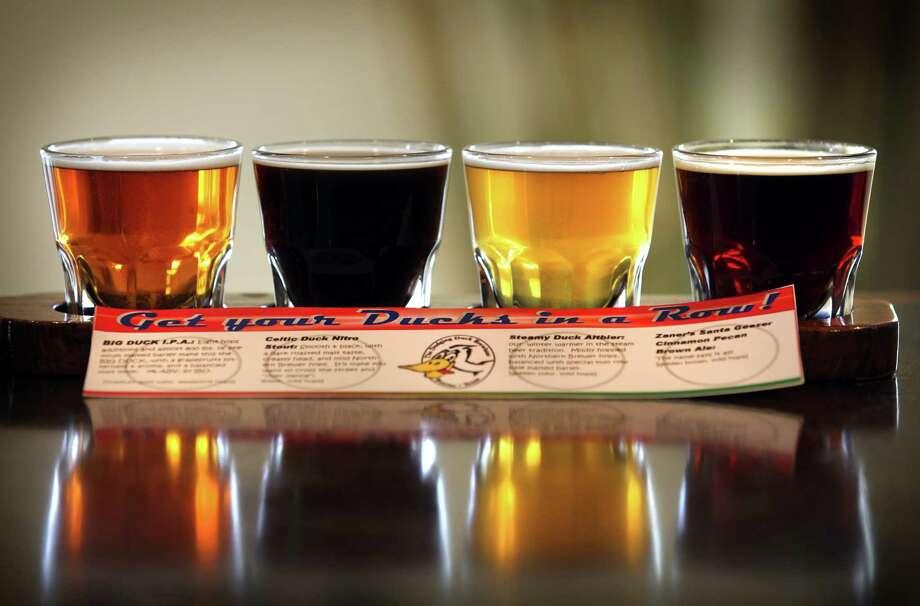 A beer flight at Dodging Duck Brewhaus in Boerne. Photo: BOB OWEN, San Antonio Express-News / © 2012 San Antonio Express-News