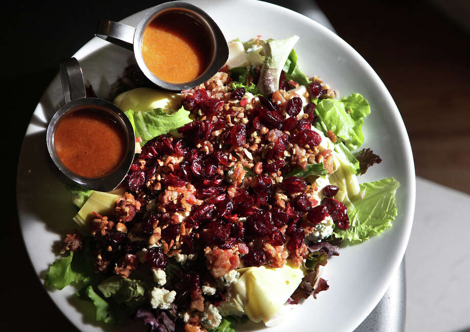 The Heart of Boerne Salad is highlighted with glowing dried cranberries at Dodging Duck Brewhaus in Boerne, TX. Monday, Jan. 7, 2013. Photo: BOB OWEN, San Antonio Express-News / © 2012 San Antonio Express-News