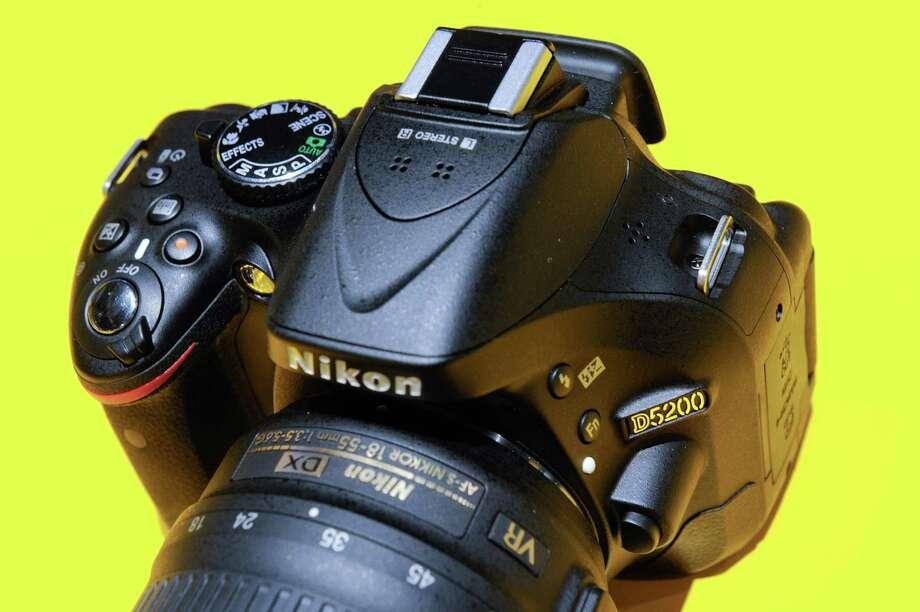 The Nikon Corp. D5200 digital single lens reflex (DSLR) camera at the 2013 Consumer Electronics Show in Las Vegas on Wednesday. Photo: David Paul Morris, Bloomberg / © 2013 Bloomberg Finance LP