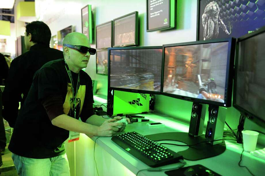 An attendee plays a 3D video game at the Nvidia Corp. booth at the 2013 Consumer Electronics Show in Las Vegas, Nevada, U.S., on Wednesday, Jan. 9, 2013. The 2013 CES trade show, which runs until Jan. 11, is the world's largest annual innovation event that offers an array of entrepreneur focused exhibits, events and conference sessions for technology entrepreneurs. Photographer: David Paul Morris/Bloomberg Photo: David Paul Morris, Bloomberg / © 2013 Bloomberg Finance LP