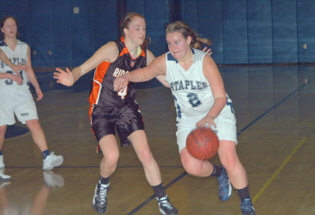 Staples High guard Margaret Fair tries to drive to the basket in the Wreckers' 58-27 loss to Ridgefield on Tuesday Jan. 8, 2013 in Westport, Conn. Photo: Contributed Photo