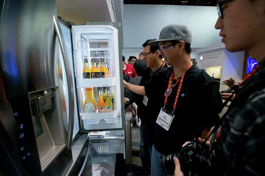 Attendees look at an LG Electronics Inc. refrigerator. Photo: David Paul Morris, Bloomberg / © 2013 Bloomberg Finance LP