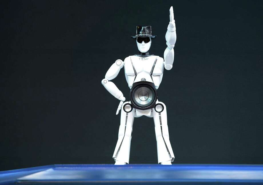 A robot from Vietnam's Tosy Future Robot dances to music. Photo: JOE KLAMAR, AFP/Getty Images / AFP