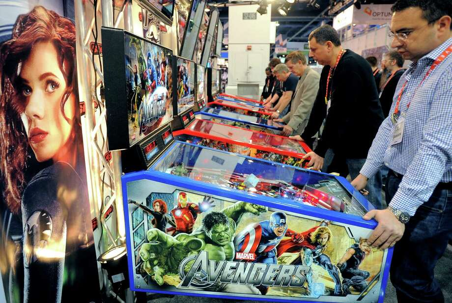 Consumers play at the Stern Pinball booth at the 2013 International CES. Photo: JOE KLAMAR, AFP/Getty Images / AFP