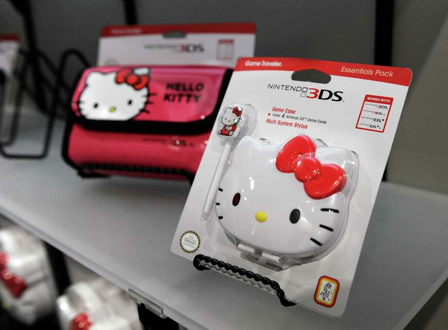 """Hello Kitty"" branded video game cases are seen at the R.D.S. booth. Photo: David Becker, Getty Images / 2013 Getty Images"