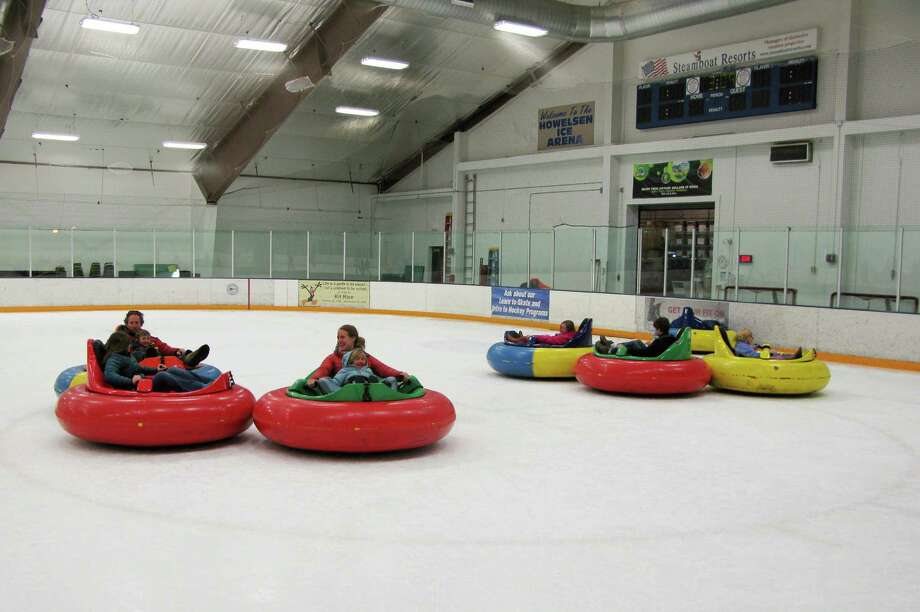 This photo shows bumper cars on ice at Howelsen Ice Arena in Steamboat Springs, Colo. The activity is one of a number of relatively new diversions being offered in winter recreation destinations, along with airboarding, snow bikes and snowkiting. (AP Photo/Karen Schwartz) Photo: Karen Schwartz, STR / AP