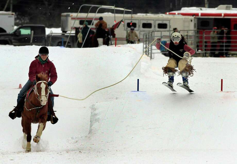 """You may think you know all the winter sports, but there are way more than just your typical activities. Check out these hidden treasures of winter.Equestrian SkijoringBecause this consists of a skier being pulled by a horse, most ski resorts only allow experienced skiers to participate. The name comes from the Norwegian word for """"ski-driving."""" The sport is primarily seen at winter carnivals and cowboy competitions.  Photo: Jim Cole, STF / AP"""