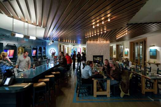 In Snowmass, the bar at the revamped Wildwood resort serves up Belgian beers and a hip vibe. Photo: Michael Paulsen, Staff / © 2012 Houston Chronicle