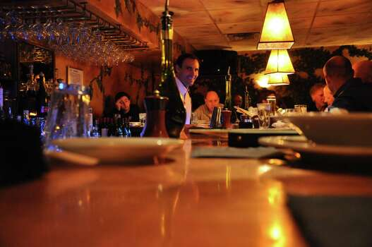 Popular Italian restaurant Campo de Fiori in Aspen is known for its  boisterous bar scene and handsome bartenders. Photo: Melissa Ward Aguilar