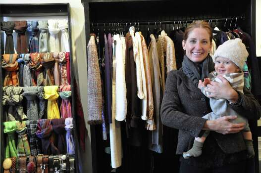 Keele Loyd poses with her son at The Little Bird, her high-fashion designer consignment boutique in Aspen. Photo: Melissa Aguilar
