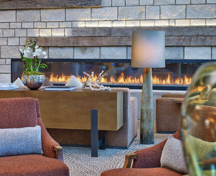 A fireplace warms the lobby at the new Westin Snowmass Resort. / Westin