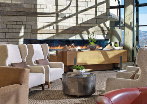 The lobby of the Westin Snowmass Resort looks out to the ski slopes. / Westin