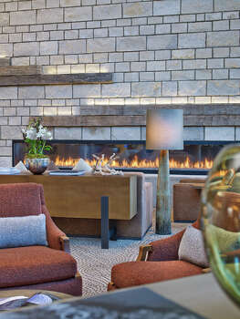 A lobby fireplace warms the Westin Snowmass. / Westin