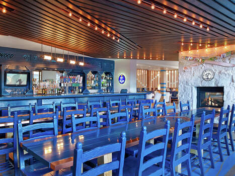 Bold blue chairs punctuate the bar at the new Wildwood hotel in Snowmass. / Westin