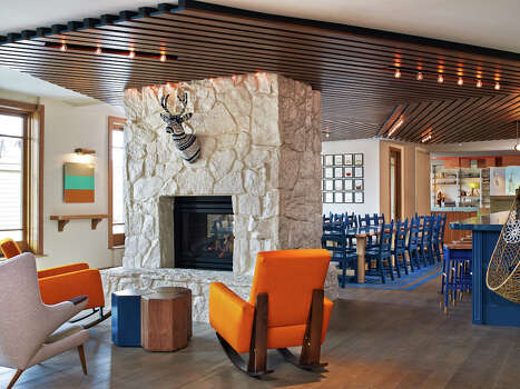 There's plenty of seating and a fireplace in the bar area of the new Wildwood hotel in Snowmass. / Westin