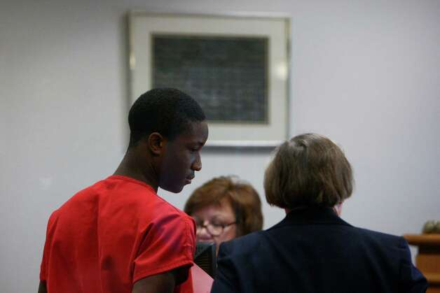 Ja'mari Alexander-Alan Jones is led out of a courtroom during a hearing on Thursday, January 10, 2013 at the King County Courthouse in downtown Seattle. Jones, convicted in the 2009 killing of Seattle's 'Tuba Man,' is suspected in a Christmas Eve killing at Bellevue's Mirror Lounge at Munchbar. Photo: JOSHUA TRUJILLO / SEATTLEPI.COM