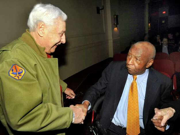 "In this file photo Pasquale Pepe, of Shelton, left, greets Jeff Wiggins at the showing of ""The Fields of Margraten: Bitter Harvest."" Pepe fought in one of the battles near Margraten that led to Jefferson's Army company digging the largest grave for U.S. forces in World War II. The film was shown as the closing selection of the Connecticut Film Festival at The Palace Theatre in Danbury, Sunday, April 10, 2011. Photo: Michael Duffy, ST / The News-Times"