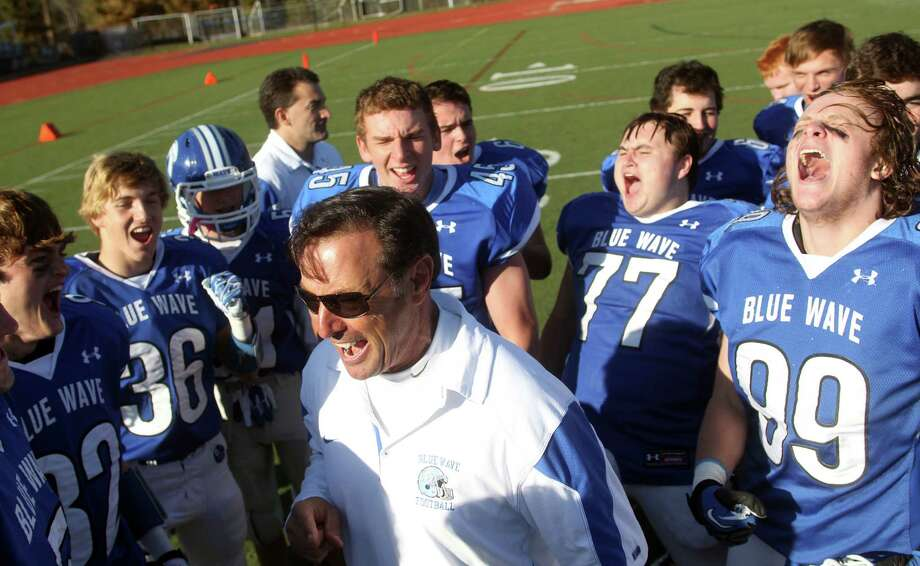 Darien Head Coach Rob Trifone celebrates with his team following a 36-23 drubbing of New Canaan. New Canaan, which led 14-0 in the first quarter was man handled by the Blue Wave the rest of the way. It was Darien's first Turkey Day win since the 2001. Photo: J. Gregory Raymond / Stamford Advocate Freelance;  © J. Gregory Raymond
