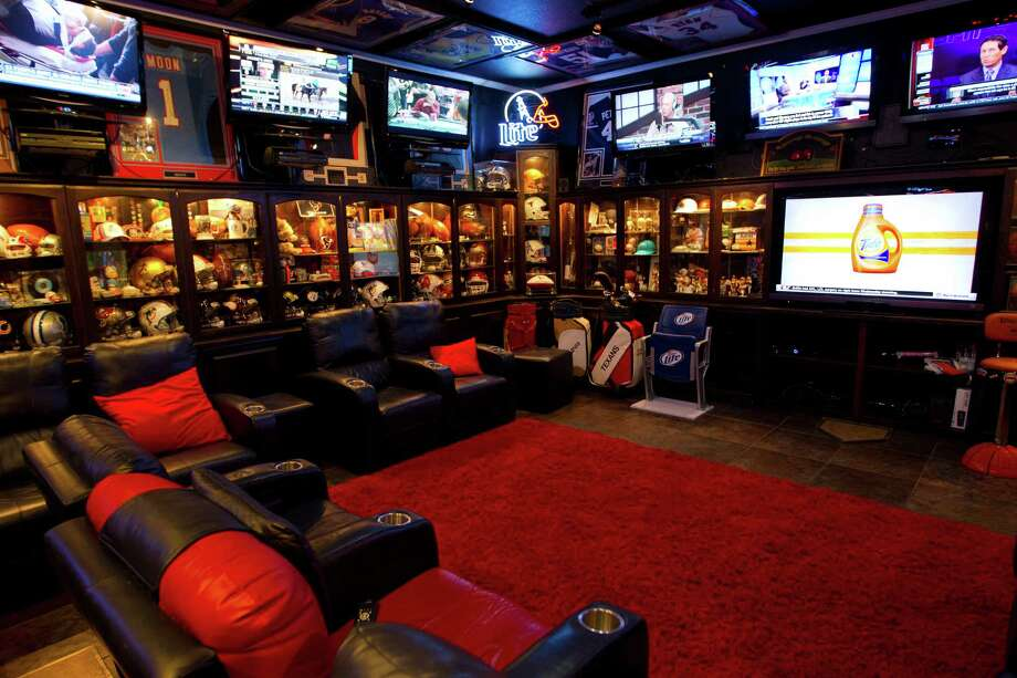 Blake Barnes, a Texans fan, has created his man cave that can seat about 50 people with multiple televisions, and hundreds of sports memorabilia, Wednesday, Jan. 9, 2013, in Deer Park. Photo: Karen Warren, Houston Chronicle / © 2013 Houston Chronicle