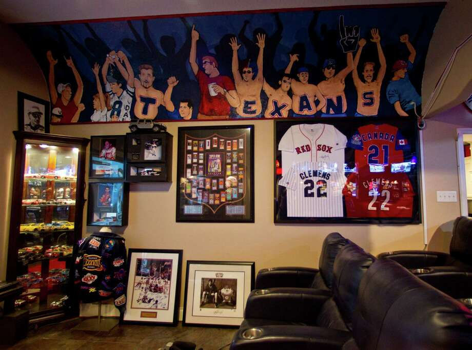 A hand painted mural on the wall  inside the man cave owned by Blake Barnes, a Texans fan, whose man cave can seat about 50 people with multiple televisions, and hundreds of sports memorabilia, Wednesday, Jan. 9, 2013, in Deer Park. Photo: Karen Warren, Houston Chronicle / © 2013 Houston Chronicle