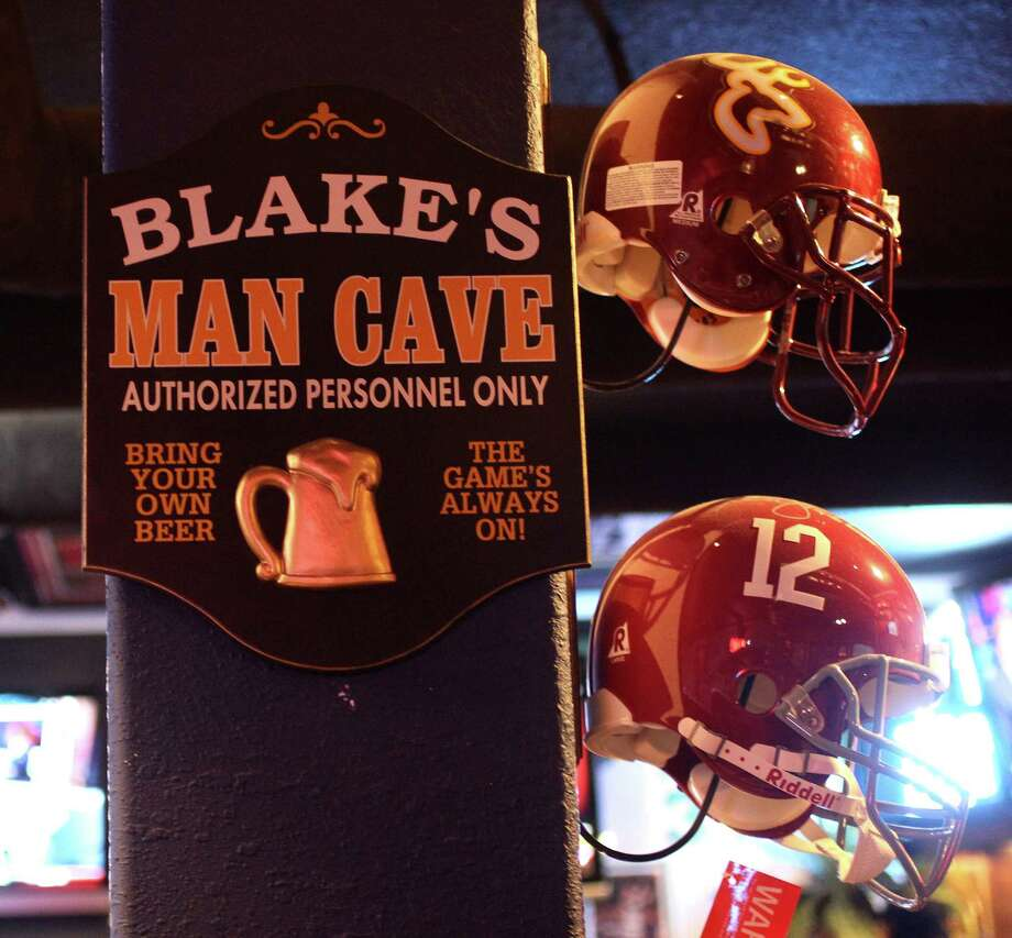 "A sign reads ""Blake's Man Cave"" inside the man cave owned by Blake Barnes, a Texans fan, whose man cave can seat about 50 people with multiple televisions, and hundreds of sports memorabilia, Wednesday, Jan. 9, 2013, in Deer Park. Photo: Karen Warren, Houston Chronicle / © 2013 Houston Chronicle"