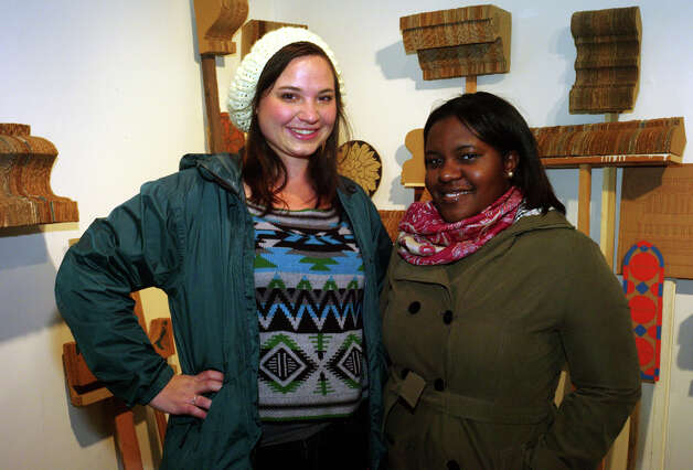 Caitlin Cervenka (left) and Kezia Southern gather at the 1st Friday exhibit at the UTSA Satellite Space. Photo: Leland A. Outz, For The Express-News / SAN ANTONIO EXPRESS-NEWS
