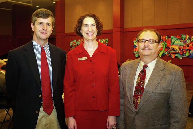 Speaker David Crockett (from left), alumni relations senior director Mary Kay Cooper and alumni board member Ivan Phinney gather at the Food for Thought lecture at Trinity University. Photo: Leland A. Outz, For The Express-News / SAN ANTONIO EXPRESS-NEWS