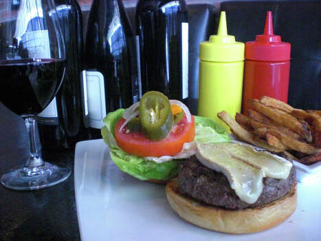 Max's Wine Dive, 340 E. Basse Road, Suite 101: Go gourmet with Max's Kobe Burger made with a half-pound of Beeman Ranch Texas Wagyu beef served on an artisan bun. It was named one of the 50 best burgers in Texas by Texas Monthly magazine. www.maxswinedive.com Photo: Max's Wine Dive / Handout Email