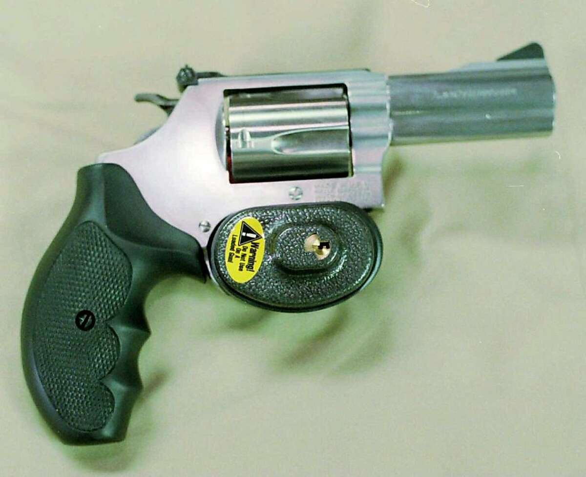 (NYT15) UNDATED -- Oct. 8, 1997 -- GUN-LOCKS-CLR, 10-8 -- After negotiating with the Clinton administration, officials say the manufacturers of most handguns in the U.S. will gather at the White House on Thursday to announce that they will provide child-safety locks with their firearms by the end of next year. Smith & Wesson, whose revolver includes a trigger lock, and Sturm, Ruger and Co. already ship locks with all their handguns. (Phillippe Diederich/New York Times Photo)