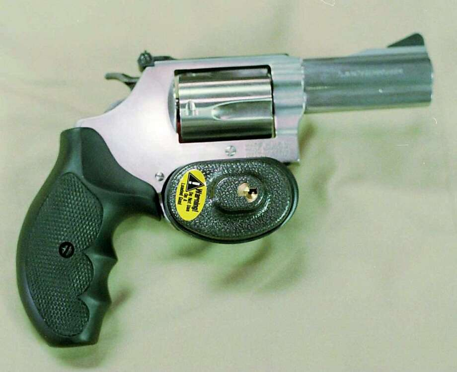 (NYT15) UNDATED -- Oct. 8, 1997 -- GUN-LOCKS-CLR, 10-8 -- After negotiating with the Clinton administration, officials say the manufacturers of most handguns in the U.S. will gather at the White House on Thursday to announce that they will provide child-safety locks with their firearms by the end of next year. Smith & Wesson, whose revolver includes a trigger lock, and Sturm, Ruger and Co. already ship locks with all their handguns. (Phillippe Diederich/New York Times Photo) Photo: Phillippe Diederich, NYT