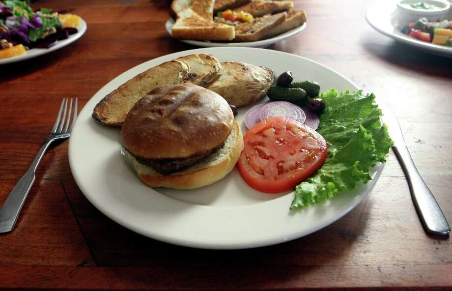 Liberty Bar, 1111 S. Alamo St.:Here, the basic beef burger has plenty of fans, but the menu also includes burgers with lamb (pictured) and venison. www.liberty-bar.com Photo: HELEN L. MONTOYA, SAN ANTONIO EXPRESS-NEWS / hmontoya@express-news.net