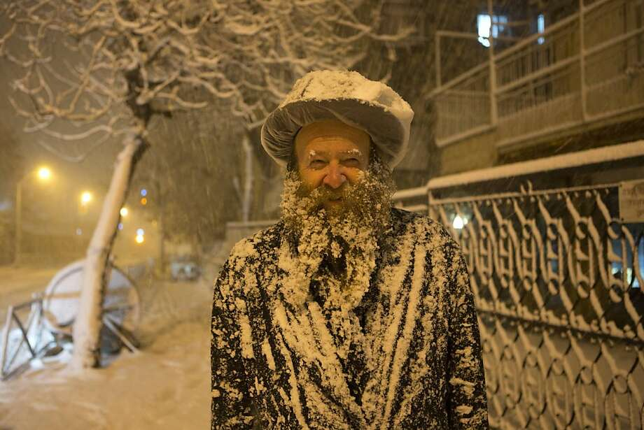 Holy Land a winter wonderland:Wet flakes cover an Ultra-Orthodox Jewish man during the biggest snowstorm in Jerusalem in a decade. Photo: Menahem Kahana, AFP/Getty Images