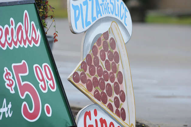 Pizza Sign at Gino's on Dowlen. Photo taken Thursday, January 10, 2013 Guiseppe Barranco/The Enterprise Photo: Guiseppe Barranco, STAFF PHOTOGRAPHER / The Beaumont Enterprise