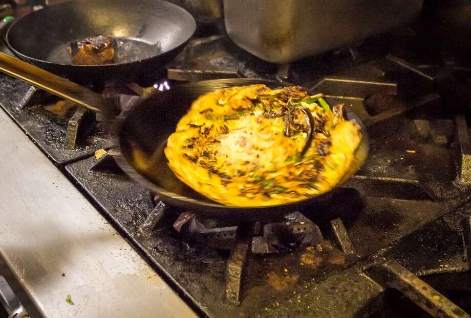 Sous chef Daniel Lim cooks the okonomiyaki.