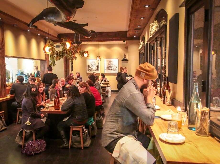 People enjoy an early dinner at Namu Gaji in San Francisco.