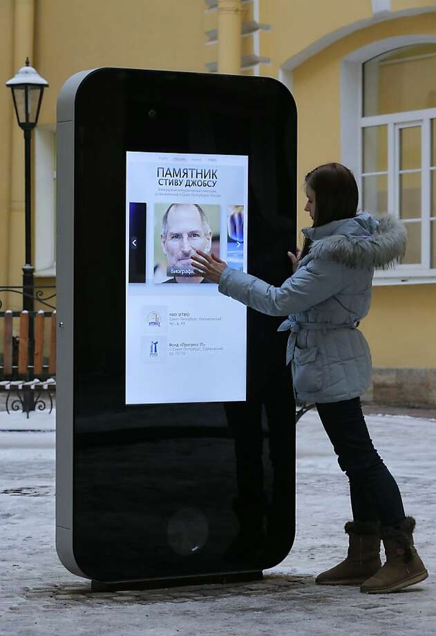 Theft-proof iPhone: A giant iPhone memorial to Apple founder Steve Jobs stands in the courtyard of the Techno Park of the St. Petersburg National Research University of Information Technologies, Mechanics and Optics in St. Petersburg, Russia. Photo: Dmitry Lovetsky, Associated Press