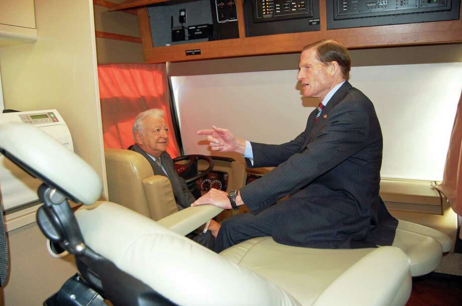 Norwalk Mayor Richard Moccia sits in the driver's seat of Norwalk Community Health Centerís new Health on Wheels, or ìHOWî bus, while discussing healthcare with U.S. Richard Blumenthal, who is sitting in a dental chair on the bus. Photo: Nicole Rivard
