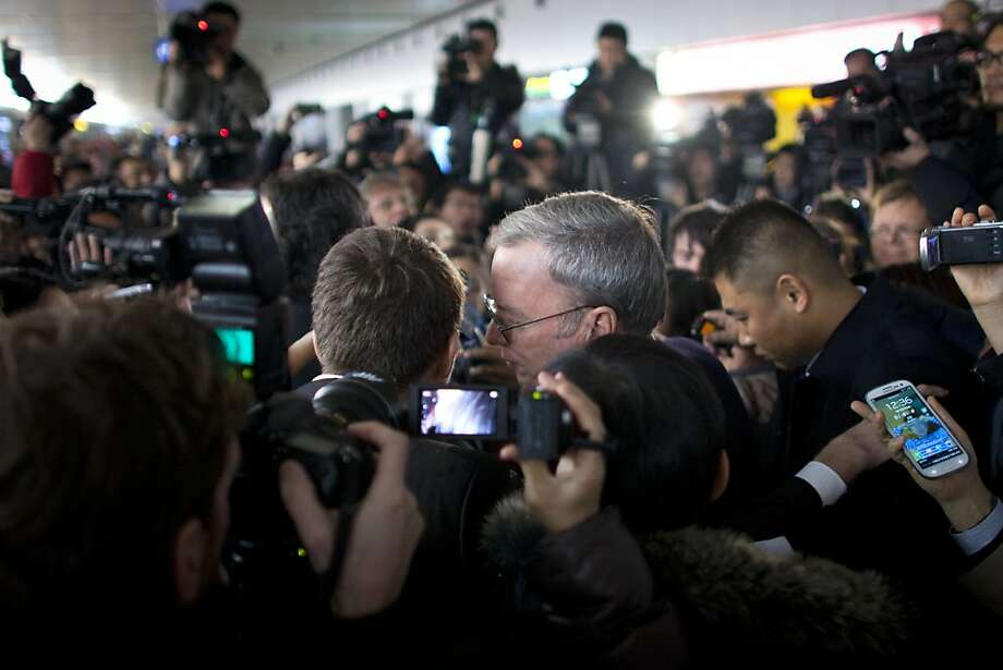 Google Chairman Eric Schmidt is surrounded by journalists after arriving in Beijing on Jan. 10. Photo: Alexander F. Yuan, Associated Press