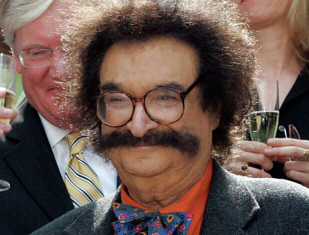 "FILE - In this May 31, 2006 file photo, film critic Gene Shalit is seen during a toast with ""Today"" show cast and crew at the end of Katie Couric's final show, in New York. A misdemeanor driving charge against retired television movie critic Gene Shalit is set to be dismissed in Massachusetts. The hearing was continued to April 2, when the driving to endanger charge will be dismissed.  (AP Photo/Richard Drew, File) Photo: Richard Drew"