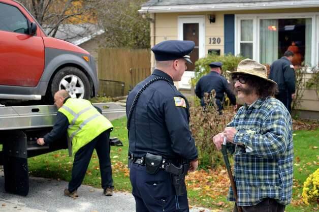 FILE - In this Oct. 24, 2012 file photo, television movie critic Gene Shalit, right, talks with a Lenox, Mass., police officer after crashing his car into a house on Housatonic Street in Lenox. A misdemeanor driving charge against retired television movie critic Gene Shalit is set to be dismissed in Massachusetts. The hearing was continued to April 2, when the driving to endanger charge will be dismissed.  (AP Photo/The Berkshire Eagle, Ben Garver) Photo: Ben Garver