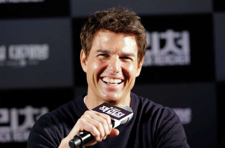 "U.S. actor Tom Cruise answers reporters' questions during a news conference to promote his film ""Jack Reacher"" in Seoul, South Korea, Thursday, Jan. 10, 2013. Even though he turned 50 last summer and has been a Hollywood star for three decades, Tom Cruise says he still has fun making movies. (AP Photo/Lee Jin-man) Photo: Lee Jin-man"