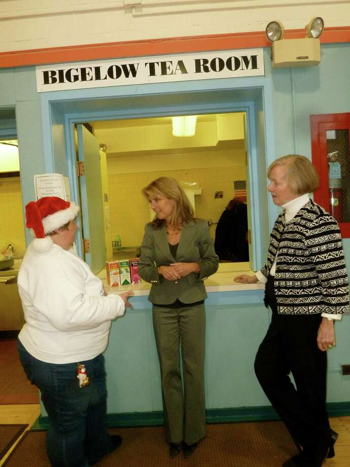 Cindi Bigelow, president of The Bigelow Tea Co., center, stands with Toni Glore, manager of the Fairfield Senior Center's Bigelow Tea Coffee & Tea Room, and Claire Grace, the center's director, during a recent visit. The company recently gave the center $8,000 for MySeniorCenter, a software program designed to reduce paperwork and improve services at senior centers. Photo: Contributed Photo